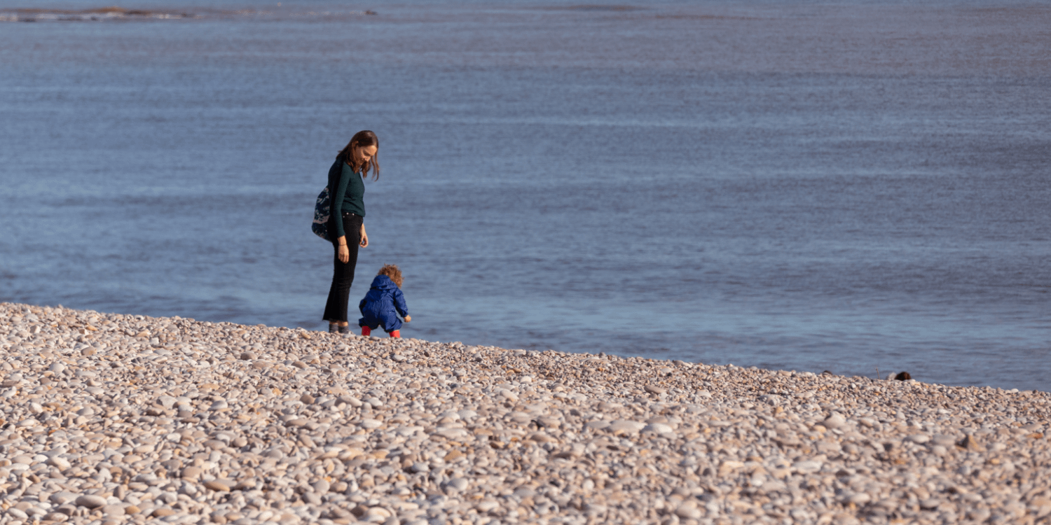 Mother and son on the beach 1
