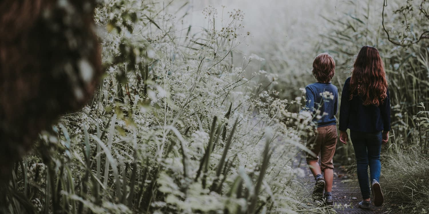 Children walking in countryside during summertime