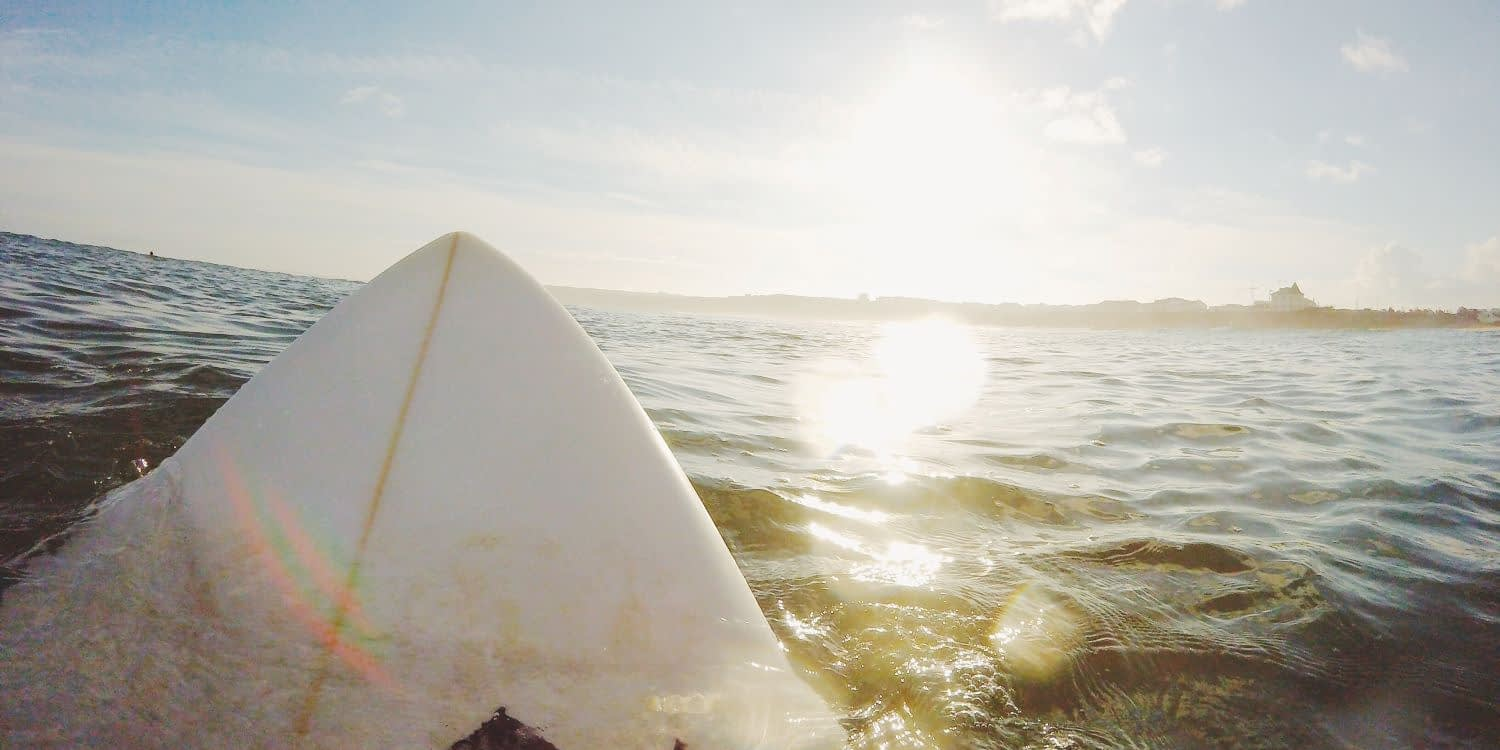Sat on the surfboard in the water
