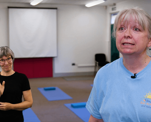 watch this video showing a se=pecially adapted yoga class as part of the Deaf Get Active Project